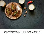 grilled steaks and beer on a... | Shutterstock . vector #1172575414
