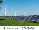 wind engines and solar panels... | Shutterstock . vector #1172589571