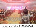 blur of light in the show room... | Shutterstock . vector #1172610844