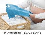 pregnant women prepare newborn... | Shutterstock . vector #1172611441