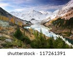 Green trees and snowy mountains - stock photo