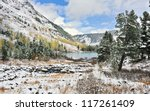 First snow in mountains - stock photo