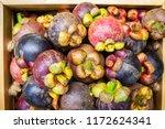 fresh mangosteen in wooden box. ... | Shutterstock . vector #1172624341