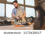 a bearded man in safety glasses ... | Shutterstock . vector #1172628517