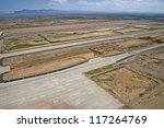 Aerial view of construction work on runway at a major airport - stock photo