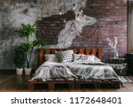 stylish bedroom in loft style... | Shutterstock . vector #1172648401