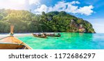 traditional long tail boat on... | Shutterstock . vector #1172686297