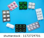 different pills on blue... | Shutterstock . vector #1172729701