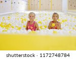 two girls are playing  in pool... | Shutterstock . vector #1172748784