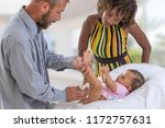 baby changing. loving father... | Shutterstock . vector #1172757631