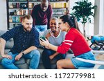 cheerful group of male and... | Shutterstock . vector #1172779981