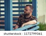 man in caffe | Shutterstock . vector #1172799361