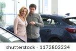 mature couple choosing a new... | Shutterstock . vector #1172803234