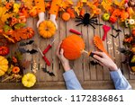 family carving halloween... | Shutterstock . vector #1172836861