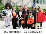 diverse kids in halloween... | Shutterstock . vector #1172863264