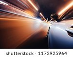 car on the road with motion... | Shutterstock . vector #1172925964