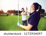 happy golf player couple giving ... | Shutterstock . vector #1172934097