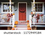 Stock photo halloween pumpkins and decorations outside a house 1172949184