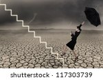 Businesswoman is walking up line of stairs while holding umbrella in stormy weather - stock photo
