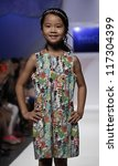 NEW YORK - OCTOBER 21: Girl walks runway for petite Parade show by Baby CZ during kids fashion week sponsored by Vogue Bambini & Swarovski Elements at Industria Superstudio on October 21, 2012 in NYC - stock photo
