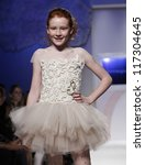 NEW YORK - OCTOBER 21: Girl walks runway for petite Parade show by Bonnie Young during kids fashion week sponsored by Vogue Bambini & Swarovski Elements at Industria Superstudio on Oct 21, 2012 in NYC - stock photo
