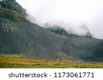 volcanic mountains in a fog ... | Shutterstock . vector #1173061771