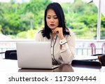 worried singaporean young... | Shutterstock . vector #1173094444