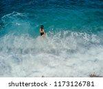 girl goes in to the ocean   Shutterstock . vector #1173126781