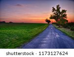 colorful sunset with asphalt... | Shutterstock . vector #1173127624