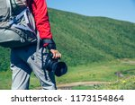 woman hiker  with camera in the ... | Shutterstock . vector #1173154864