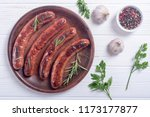 grilled sauusages on a plate ....   Shutterstock . vector #1173177877