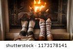 closeup photo of feet in woolen ... | Shutterstock . vector #1173178141