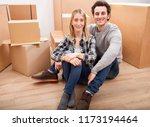 happy young couple moving to... | Shutterstock . vector #1173194464