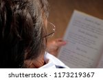 lady reading with glasses | Shutterstock . vector #1173219367