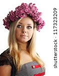 Beautiful blonde in a wreath of pink chrysanthemums - stock photo