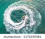 people are playing a jet ski in ... | Shutterstock . vector #1173235381
