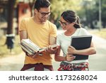 young student couple going to... | Shutterstock . vector #1173268024