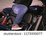 biker in jeans riding a... | Shutterstock . vector #1173350077