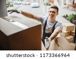 a young handsome smiling mover... | Shutterstock . vector #1173366964