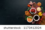 set the sauces on a black... | Shutterstock . vector #1173412024