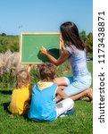 mathematics lesson on open air | Shutterstock . vector #1173438871
