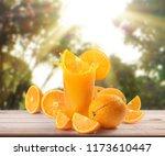 orange  on white a wooden table | Shutterstock . vector #1173610447