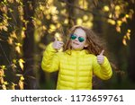lovely girl showing thumbs up ... | Shutterstock . vector #1173659761