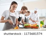 group of people and male chef... | Shutterstock . vector #1173681574
