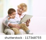grandmother reading a tale to... | Shutterstock . vector #117368755