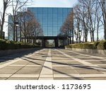 This is a shot of a modern reflecting building and walkway in Hackensack NJ. - stock photo