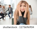 stressed woman during group... | Shutterstock . vector #1173696904