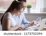 serious millennial couple read... | Shutterstock . vector #1173702394