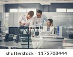three colleague in office... | Shutterstock . vector #1173703444