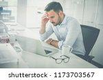.business man in office.... | Shutterstock . vector #1173703567